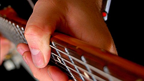 Blues Guitar Lessons - Do You NEED To Use This Grip To Play Like SRV or Hendrix?